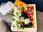 floral gift set with champagne and macaroons