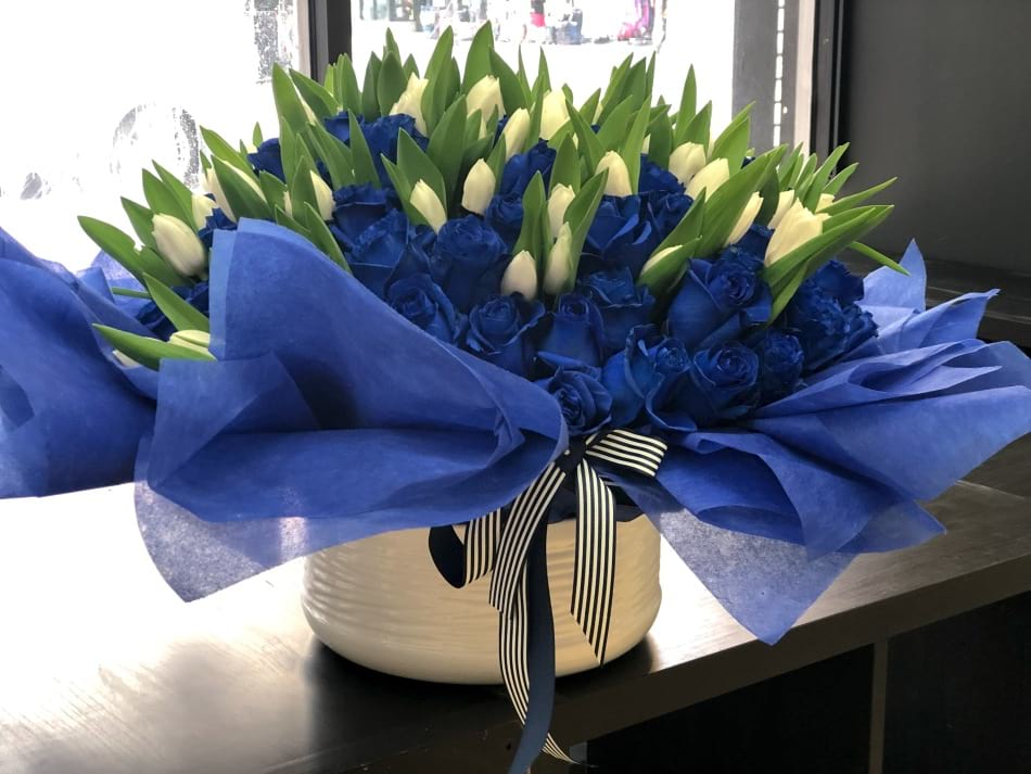 Chic Flower Arrangement with Tulips and Royal Blue Roses