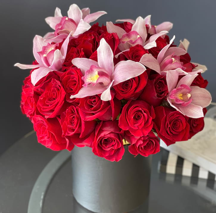 4 Dozen Red Roses and Orchids Arrangement in a Box