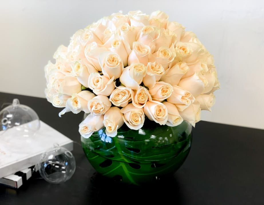 100 White Roses Arrangement in Fishbowl Vase