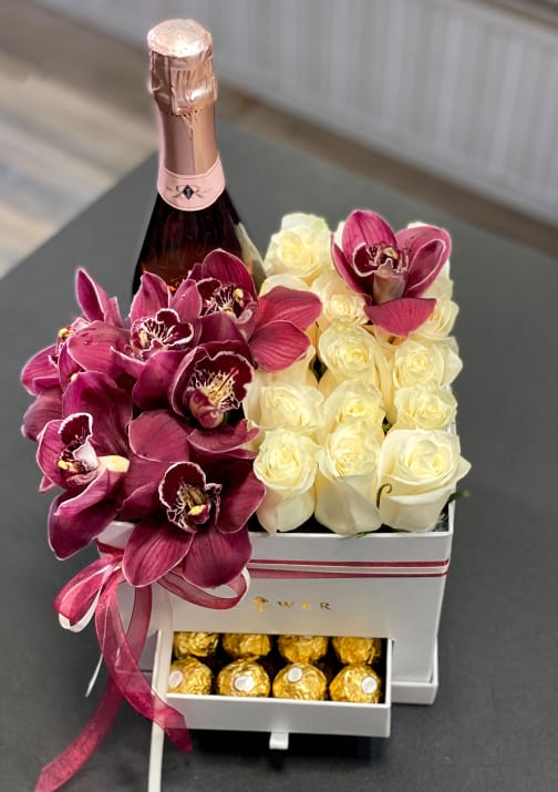 Gift Box with champagne, flowers and chocolate