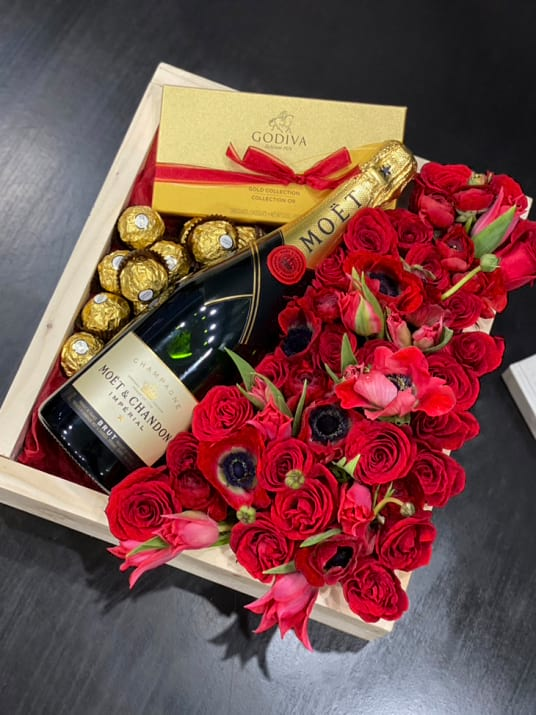Wooden Box with red flowers, Chocolate and Moet Champagne