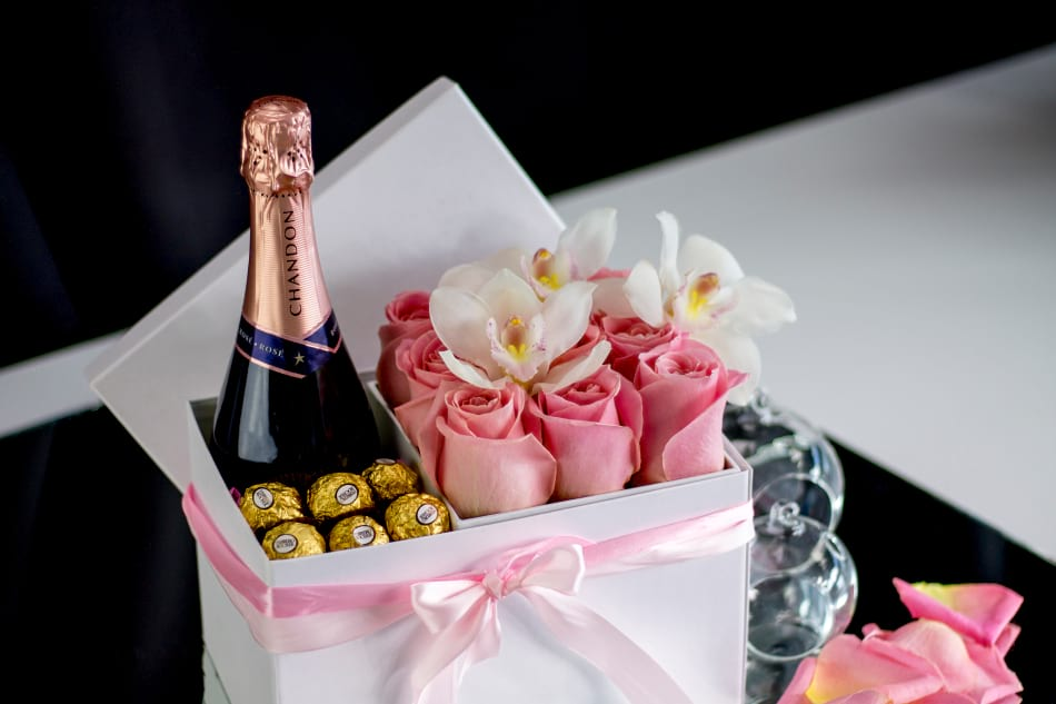 Gift Box with champagne, flowers and candies