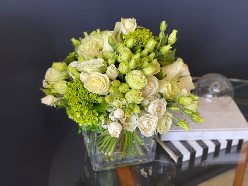 Elegant flower arrangement in white and green colors