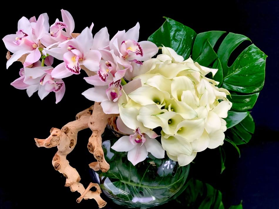 Luxe Design with cymbidium orchids and calla lilies