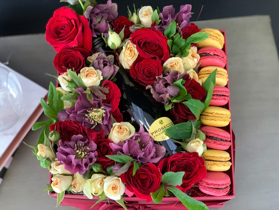 Flower Arrangement in Red and White Colors with Macaroons & Champagne