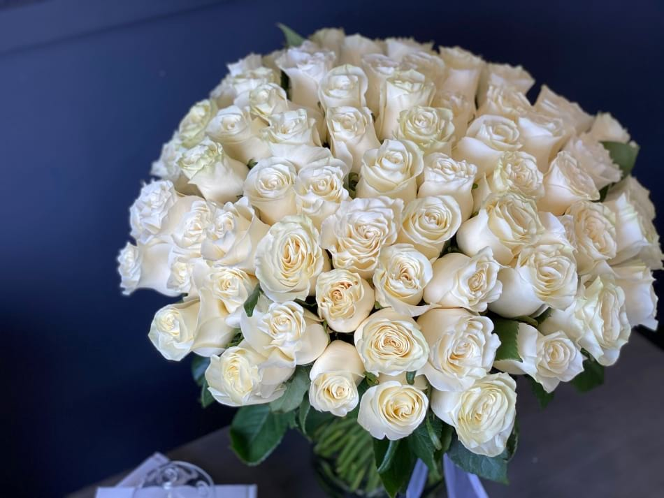 100 White Roses Arrangement in Low Vase