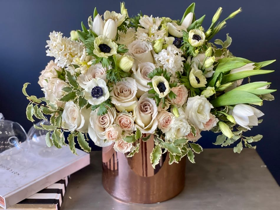 Elegant flower arrangement in gold vase