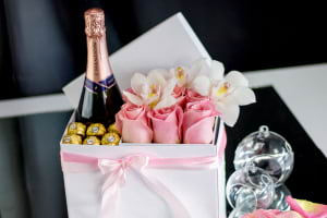 Flowers with champagne and chocolate