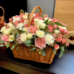 Elegant Floral Arrangement in wooden basket